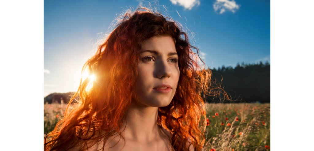 Red haired woman in sunlight