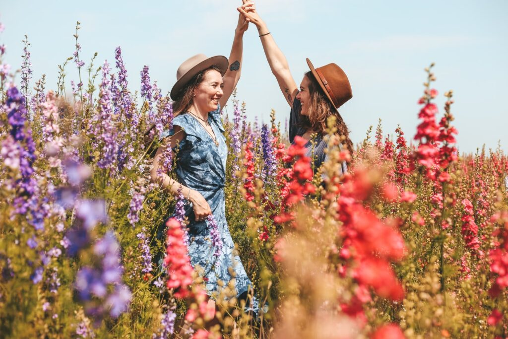 two women in a bed of lupins